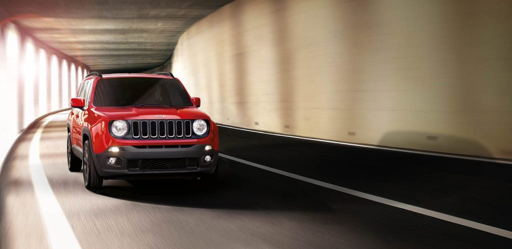 Red Jeep Renegade City Driving